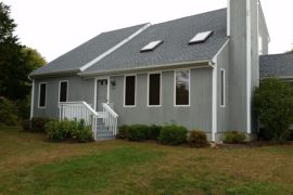 Siding and Stone Chimney Project